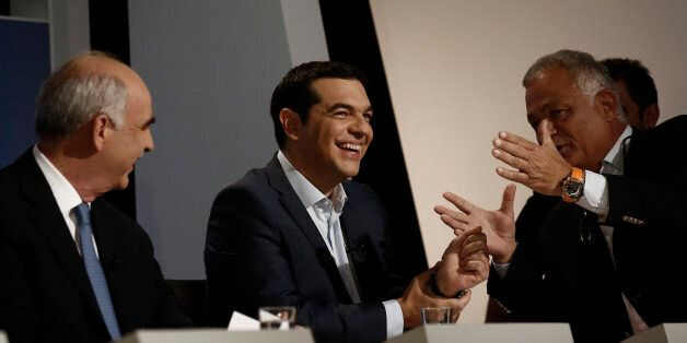 Alexis Tsipras, former Greek prime minister, center, and Evangelos Meimarakis, leader of the New Democracy...