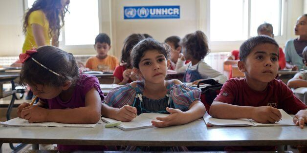 Syrian refugee students attend a class in an accelerated learning programme at public school in Kamed...