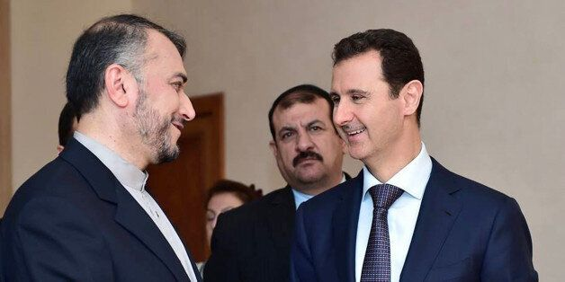 In this photo released on the official Facebook page of the Syrian Presidency, Syrian President Bashar...