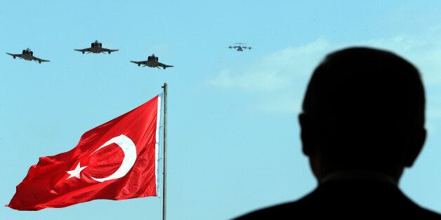 ANKARA, TURKEY - AUGUST 30: President of Turkey Recep Tayyip Erdogan watches the performance of the aerobatic...