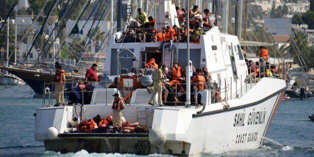 MUGLA, TURKEY - SEPTEMBER 15: Turkish Coast Guard rescue refugees after a vessel with refugees on board...