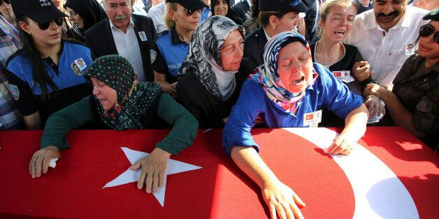Hulya Aydin, right, the mother of Turkish police special operations officer Sahin Polat Aydin, one of...