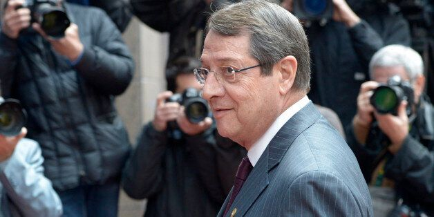 Cypriot President Nikos Anastasiadis arrives at an EU summit in Brussels on Wednesday, May 22, 2013....