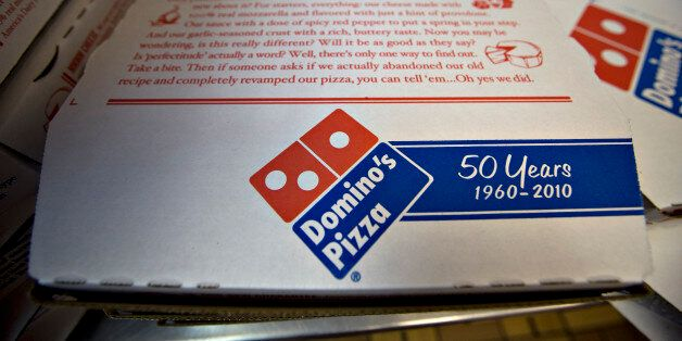 Pizza boxes sit inside a Domino's Pizza franchise on 89th Street in New York, U.S., on Wednesday, Jan....