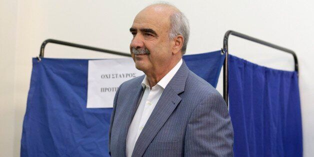 Leader of New Democracy main opposition party Vangelis Meimarakis casts his vote at a polling station...