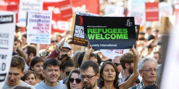 LONDON, UNITED KINGDOM - SEPTEMBER 12: Protesters attending a pro-refugee march in London, England on...