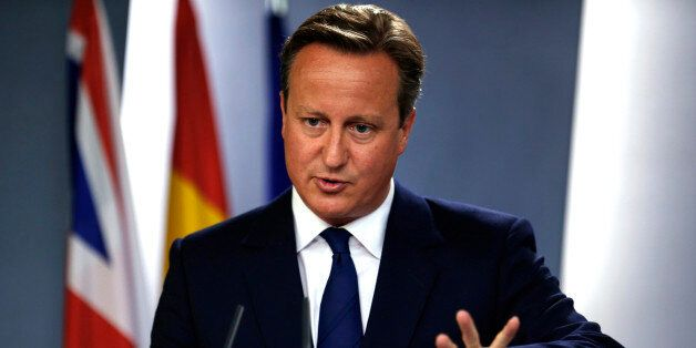 Britain's Prime Minister David Cameron talks to journalists during a joint news conference with his Spanish...