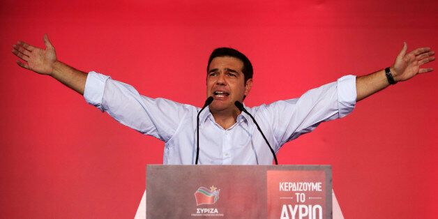 Syriza left-wing party leader and former Prime Minister Alexis Tsipras gestures as he delivers a pre-election...