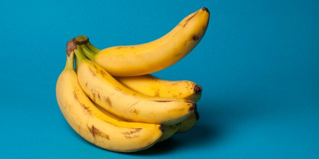 A bunch of bananas with one banana sticking up, suggestive of an