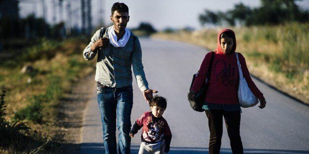 A migrant family walks on a road near the southern Serbian town of Presevo, near the border with Macedonia,...
