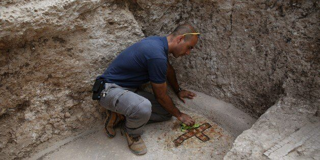 Israeli archeologist Dan Shachar, of the Israel Antiquities Authority, works on September 21, 2015 at...