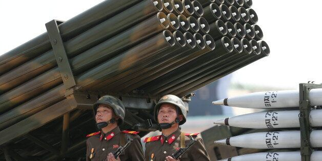 North Korean soldiers parade through the Kim Il Sung Square with their missiles and rockets, Saturday,...