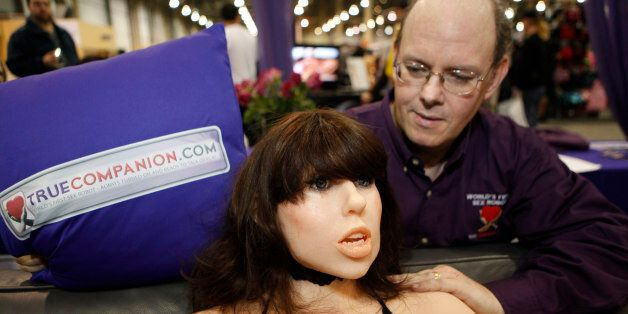 Douglas Hines, founder of True Companion, poses with a life-size rubber doll named Roxxxy during the...
