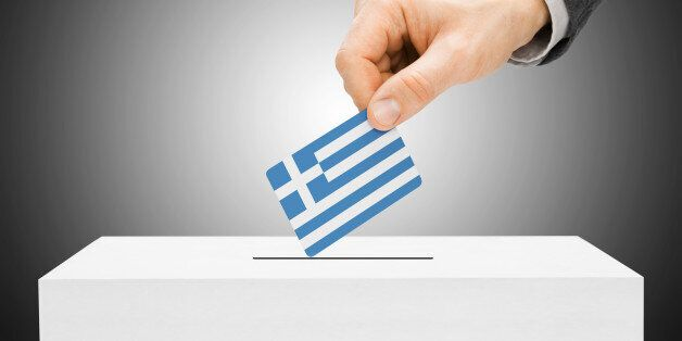 Voting concept - Male inserting flag into ballot box -