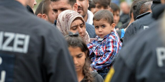 German policemen register refugees at the rail station in Freilassing, Germany, Monday, Sept. 14, 2015,...
