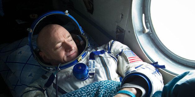 201103160010hq (16 March 2011) --- NASA astronaut Scott Kelly, Expedition 26 commander, looks out the...
