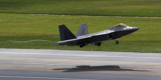 FILE - In this Aug. 14, 2012 file photo, a U.S. Air Force F-22 Raptor stealth fighter takes off from...
