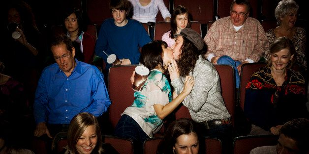 Kissing couple disturbing audience in movie theater
