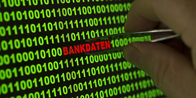 Hand reaching for the word Bankdaten, German for Banking information with tweezers in a binary