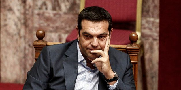Alexis Tsipras, Greece's prime minister, pauses while attending a vote by lawmakers on a bailout deal...