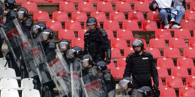 File - In this April 21 2004 photo Gendarmerie officers and soccer fans during a Serbia-Montenegro Cup...