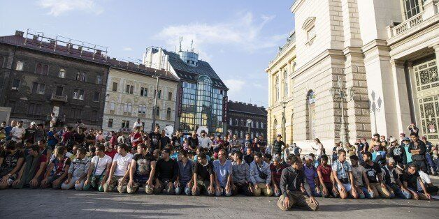 BUDAPEST, HUNGARY - SEPTEMBER 02 : Migrants perform prayer outside Keleti station which remains closed...