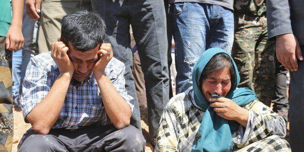 KOBANI, SYRIA - SEPTEMBER 4: Abdullah Kurdi (L), father of Syrian children Aylan, 2, his brother Galip,...