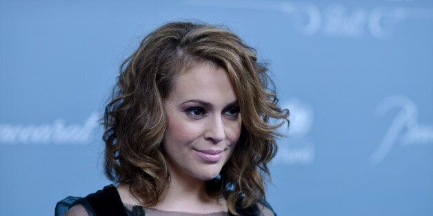 Alyssa Milano arrives at the 2014 UNICEF Ball on Tuesday, Jan. 14, 2014 in Beverly Hills, Calif. (Photo...
