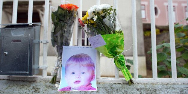 Flowers and a picture of three-year-old child Bastien are seenat the entrance of the child's parents...
