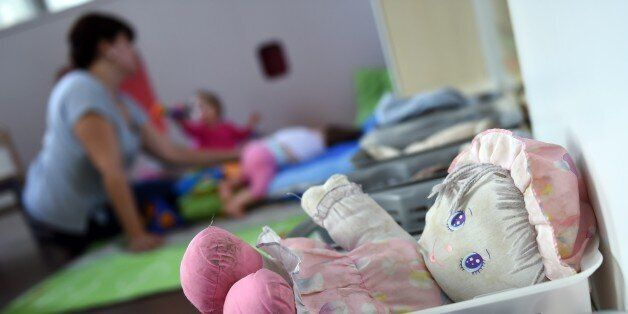 A cuddly baby doll is pictured at the childcare center of the Hopital Necker - Enfants Malades AP-HP...