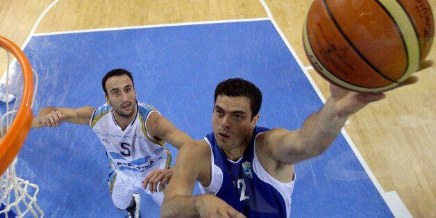 Greece's Konstantinos Tsartsaris, right, shoots as Argentina's Manu Ginobili defends during their men's...