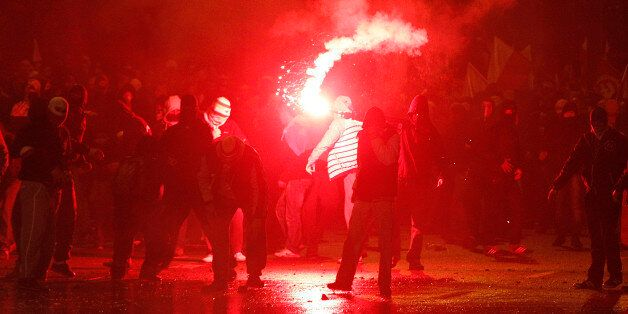 Right wing extremists throw burning flares during the Independence Day march organized by nationalist...