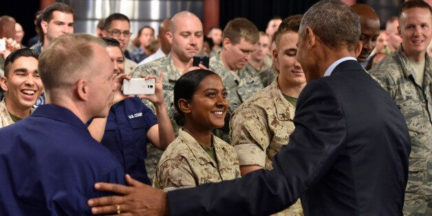 From left, Senior Chief Petty Officer Michael Hvozda watches as PFC Melanie Bowroth shakes hands with...