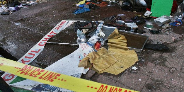 Utensils, footwear and other items are seen scattered inside a restaurant, one of the two Saturday's...