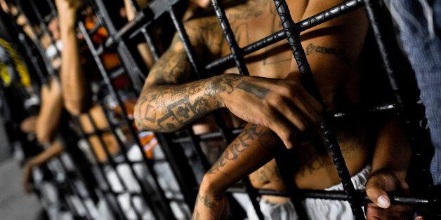 SAN SALVADOR, EL SALVADOR - FEBRUARY 20: Mara Salvatrucha gang members are seen behind the bars of cells...