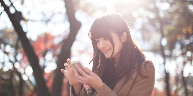 Woman feels happiness with using smartphone in a