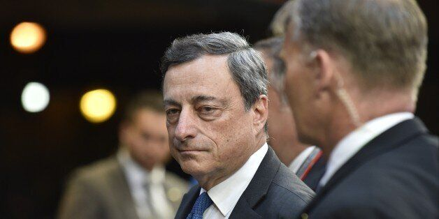 European Central Bank President Mario Draghi leaves a Eurogroup Summit meeting on June 22, 2015 at EU...