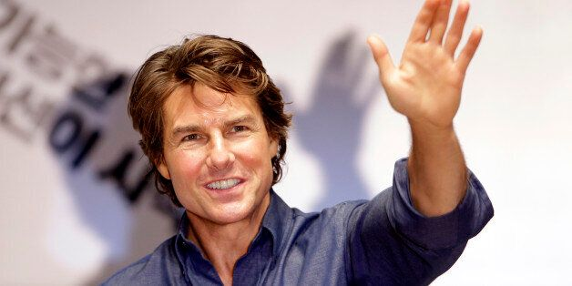 Tom Cruise waves to his fans during the guest visit event for fans to promote his latest