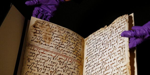 A university assistant shows fragments of an old Quran at the University in Birmingham, in Birmingham...