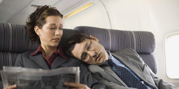Passengers sleeping and reading on
