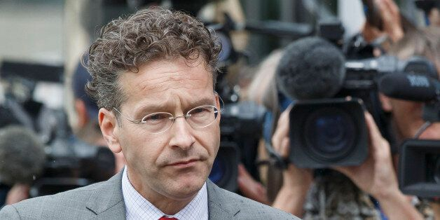 Dutch Finance Minister and chair of the eurogroup Jeroen Dijsselbloem, walks past the media after a meeting...