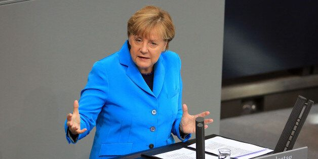 Angela Merkel, Germany's chancellor, gestures as she addresses the lower-house of the Bundestag in Berlin,...
