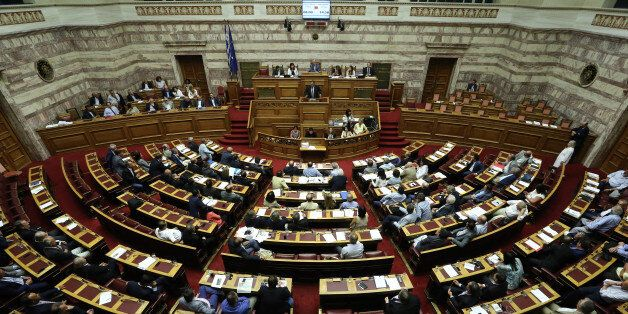 Lawmakers take part in a parliamentary session in Athens, Friday, Aug. 14, 2015. Greek lawmakers are...