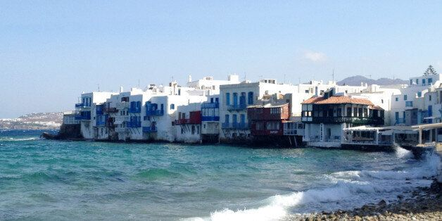 This July 6, 2014 photo shows homes tucked into the waterfront of the island of Mykonos, in an area known...