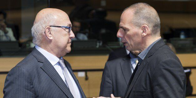 French Finance and Public Accounts Minister Michel Sapin (L) speaks with Greek Finance Minister Yanis...