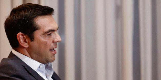 Alexis Tsipras, Greece's former prime minister, speaks to Vassiliki Thanou, Greece's interim prime minister,...