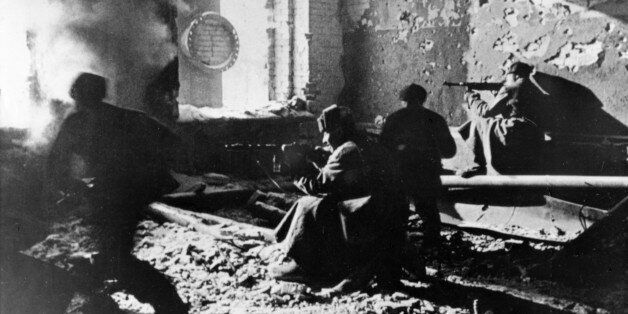 Red army soldiers fighting in ruins of krasny oktyabr (red october) works (factory), stalingrad, ussr,...