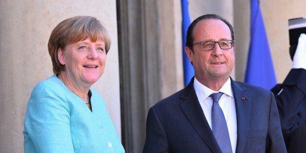 PARIS, FRANCE - JULY 06: French President Francois Hollande (R) welcomes German Chancellor Angela Merkel...