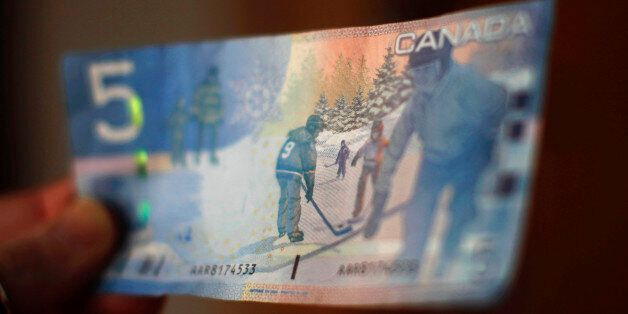 A Canadian five-dollar bill is seen in this posed photograph in Montreal March 10, 2011. The National...