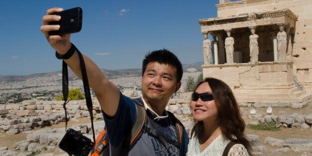Athens Greece At The Acropolis Chinese Tourists Taking Picture Of The 6 Ladies At The Erechtelon Building...